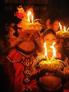 Sri Lankan traditional dancers perform during the Earth Hour ceremony at the presidential official residence in Kandy, Sri Lanka