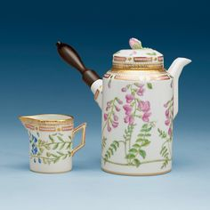 A ROYAL COPENHAGEN 'FLORA DANICA' COFFEE POT WITH COVER AND A CREAMER, DENMARK, 20TH CENTURY.