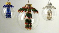 Glass Bubble Tassel Ornaments at Sova-Enterprises.com Ornaments with a twist! The tassel is INSIDE the clear glass sphere. A lovely matching beaded collar circles the metal topper. Very detailed step by step instructions with large color diagrams make these ornaments quick and easy to stitch. The tassels are great alone and the beaded collars look fab on solid color balls too!