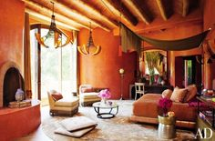 Will Smith and Jada Pinkett Smith obviously know how to decorate an exotic bedroom. The most dramatic touch? A fringed curtain draped across two bars to create a glamorous, yet simple, canopy.
