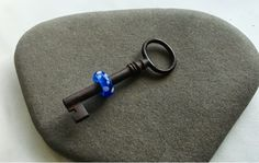 Antique key with lampwork bead
