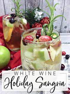 White Wine Holiday Sangria Sangrias are my all-time favorite. Like these White Wine Holiday Sangrias made with white wine, apple, cranberry and rosemary. Perfect for the Holidays! Winter Sangria, Cranberry Sangria, Holiday Sangria, White Wine Sangria, Christmas Cocktails, Holiday Cocktails, White Wines, White Christmas Sangria Recipe, White Wine Punch