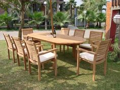 """New 7 Pc Luxurious Grade-A Set - 94"""" Oval Table and 6 Stacking Arm Chairs [Model:HR1] by WholesaleTeak. $1445.99. You can lengthen the table with minimal effort by simply opening the butterfly leaf extensions.. ADD SUNBRELLA FABRIC CUSHIONS BY SEARCHING """"Wholesaleteak Dining Cushion"""" ON AMAZON, CUSTOM MADE FOR THESE STYLE CHAIRS. Table Dimension: Approx.71"""" L (without extension) and 94"""" L (with extension), 40"""" W , 29 1/2"""" H.. Chair Dimension: 22"""" Width x 21"""" Depth..."""