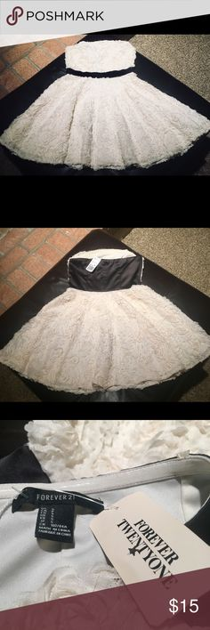 Forever 21 Party Dress For sale is a darling white party dress. It's accented with white fabric roses and a black belt in the middle. The dress hits about mid thigh. It was bought several years ago and not worn once. Would look wonderful with a black heels or boots. Forever 21 Dresses Mini