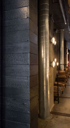 Celebrity chef and owner of Mabel's BBQ, Michael Symon teamed up with Richardson Design in Cleveland, Ohio to specify our HAI shou sugi ban charred cypress interior wall cladding.