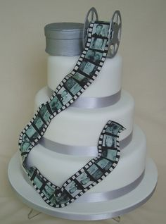 Wedding cake with file reel and canister, by 'Wow Cakes'. The photos are edible, very creative!