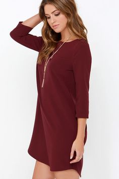 """With a dress as easy to wear as the BB Dakota Devin Burgundy Shift Dress. it will be hard to ever imagine yourself in anything else! Slip into this lightweight, woven poly-spandex number and fall in love with its wide, bateau neckline and modest three-quarter sleeves. The shift bodice is chic and relaxed as it descends to a subtle high-low hem. Unlined. Dress measures 2"""" longer at back. 96% Polyester, 4% Spandex. Hand Wash Cold or Dry Clean."""