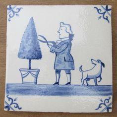 Stoneware delft tile. Huguenots of Spitalfields memorial plaque. Gardeners of Spitalfields. Barred ox-head corners motifs.