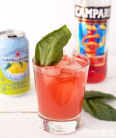 Tuscan sunset cocktail: gin + Campari + San Pellegrino Pompelmo (grapefruit sparkling beverage) + basil leaves