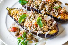 This savory stuffed eggplant with middle eastern spices and a garlic tahini sauce is a delicious and beautiful meal, one full of textures and healthy ingredients.