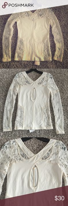 "{NWTs} Free People ""Sweet Thang"" Top New with tags! Free People ""Sweet Thang"" Long Sleeve Top. Cross back and sheer lace detail. Cream colored. Size small. Free People Tops"