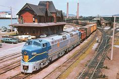 Delaware & Hudson Baldwin RF-16 locomotives # 1205 & 1216 hauling a mixed merchandise freight train on the Lehigh Valley while passing the station at Sayre, Pennsylvania, July 1975