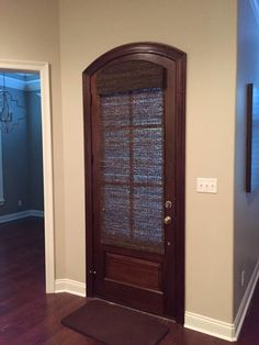 Need a little privacy for your door?  This beautiful arched stained door is covered with our woven wood shades.