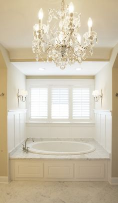 windows with plantation shutters next to a huge bathtub AND a chandelier, can you say this girls dream come true?!?!?!?!