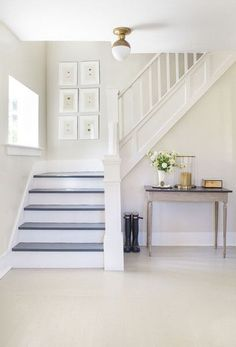 Love this white stairway - Top 25 Benjamin Moore and Sherwin Williams White Paint Colors White Staircase, Staircase Design, Staircase Ideas, Staircase Makeover, Railing Design, White Banister, White Hallway, Staircase With Landing, Staircase In Living Room
