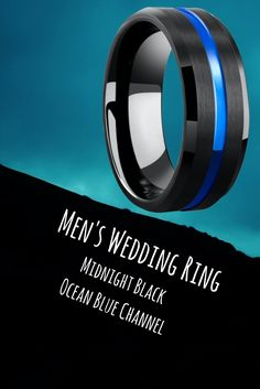 Mens black and blue wedding ring crafted out of tungsten carbide. Designed with a blue carved channel running through the center of the ring.