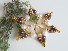 beautiful star ornament made from seed beads in various sizes and wire this star will be the highlight on your christmas tree, your table or any