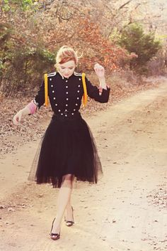 love this outfit. the contrast of the structured band jacket with the flowy tulle skirt...