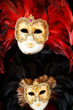 Elegant Venetian carnival masks on display on a small stand located near to the Piazza San Marco - St Mark's Square
