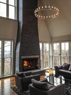 Living Room - A tall & lean fireplace crowned with a spherical round of lights.  Modern, gorgeous and an all encompassing view.  Yep, love this one!