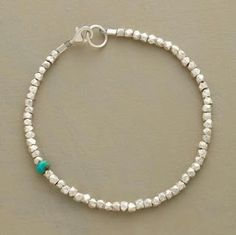 absurdly simple - love it! SINGULAR MOMENT BRACELET -- A single rondelle of turquoise makes a surprise appearance among faceted sterling silver nuggets in a bracelet you'll want to wear every day. Silver Bracelets, Jewelry Bracelets, Necklaces, Pandora Bracelets, Guy Bracelets, Silver Rings, Black Rings, Silver Beads, Handmade Bracelets