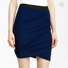 """T by Alexander Wang Skirt Color: Blue  T by Alexamder Wang Marled Jersey Twist Skirt. An ultrasoft jersey skirt is topped with a contrasting waistband and shaped by flattering twists that end in a bubble hem.  Pull-on style.Approx. length: 18"""".Lined.Rayon/polyester/spandex; machine wash.Imported. T by Alexander Wang Skirts"""