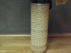 This is a 11 1/2 tall x 4 wide hand woven vase. It is woven over a glass vase with fine cane reed rimed with dark brown waxed linen. It is stunning and just beautiful with a bouquet of flowers in it. This would be a beautiful wedding gift or gift for anyone who enjoys displaying flowers. Flowers not included.