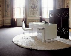 The Hyannis Port desk has rounded shoulders, a milk glass top and chromed feet. 75h x 160w x 72d cm