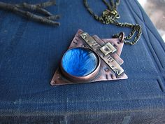 #etsy shop: Blue Glass Triangle Necklace Copper Brass Ethnic Pendant Boho Earthy Rustic Pendant Statement Mixed Metal Stamped Pendant Textured Pendant https://etsy.me/2G21HLa #rusticjewelry #bohonecklace #copperpendant #trianglependant #bluependant #mixedmetaljewelry