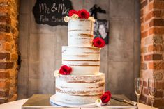 Nearly Naked Wedding Cake with Red Roses and White Calla Lilies