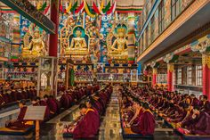 Monks gathered for the afternoon prayer session at the Namdroling monastery at Bylakuppe near Coorg, in the Mysore district of Karnataka, India.