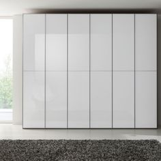 sleek white glass fitted wardrobes /   by feather and black???? research first to see interior