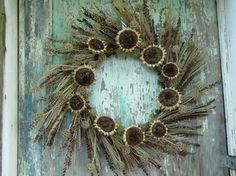 This type wreath with Peacock feathers (instead) for front door.