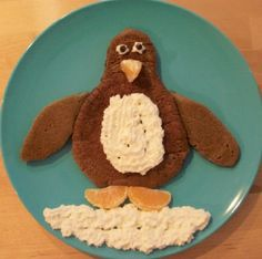 Chocolate Pancakes+Regular Pancakes+Clemintines+Yogurt+Chocolate Chips= Penguin Pancake