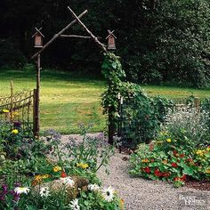 A simple -- or even an ornate -- arbor can be the perfect spot for birdhouses. Tuck smaller houses in for a subtle effect or use them as a focal point.