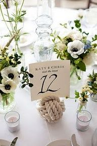 Love the little black and white flowers and small groupings. Also like the sailor knot.