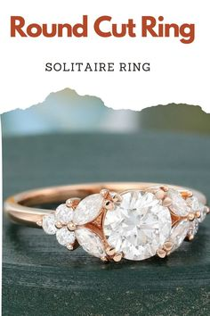 White Oval Cut Moissanite Diamond Ring, Colorless Marquise Cluster Wedding Ring, 14K/18K Rose Gold Vintage Style Proposal Ring For Women ✥ Description Of Ring :- ✥ Center Stone Details :- • Moissanite Details :- • Center Stone Shape : Oval Cut • Center Stone Weight : 0.88 CT • Center Stone Measurement : 6.00*8.00 MM • Center Stone Color : Gray • Mohs Scale : Moissanite 9.25 • Refractive Index : 2.65 (Moissanite)