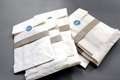 This packaging design uses simple brown paper and recycled bag, while adding extra elements to make it different from typical paper bag. This result of this is very vintage, unique and fresh. It looks very hand made and well design. We will no longer see this bag as a paper bag anymore, it looks like a bag is for a very important document.