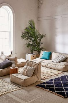 Shop colorful, convertible sofas and plush sectionals at Urban Outfitters. Find deco couches, loveseats, tufted daybeds, and more in various styles to refresh your home decor! Comfy Living Room, Loveseat Sofa, Living Room Sets, Home, Floor Pillows, Attic Rooms, Pillows, Flooring, Lounge