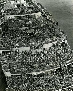 "The liner ""Queen Elizabeth"" bringing U.S Troops back to New York harbor at the end of World War II, 1945"