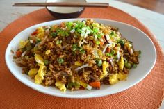This is a totally vegetarian vegetable fried rice, which is just as good as a fried rice made with meat. The addition of dark (or mushroom) soy sauce gives it a rich, darker color and great flavor.