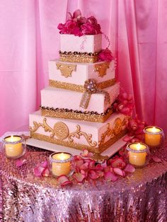 Gorgeous wedding cake in which the  flowers can be removed and switched with any color other flowers and/or a cake topper. And what a better way to high light it then with candles all around.