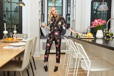 Wearing a pajama inspired silhouette, Kate Bosworth poses in Rochas Floral Blouse and Floral Pants. Lizzie Fortunato Crater Earrings and Dorateymur Turbo Jet Loafer Pumps