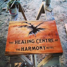 Carved and painted wood sign for The Healing Centre at The Harmony Hotel, Nosara Costa Rica Nosara, Painted Wood Signs, Costa Rica, Centre, Logo Design, Healing, Carving, Home Decor, Decoration Home