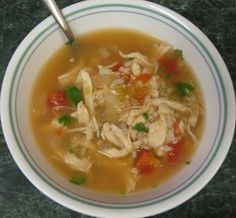 Green Chile Chicken Soup  1 onion, chopped  4 cloves garlic, minced  2 cartons of chicken broth or 64 oz.   2 cans Rotel with green chilies  1 can diced tomatoes  2 - 4 oz. cans of green chilies  2 - 3 cups cooked chicken, shredded  1/4 cup lime juice  1 1/2 tsp. cumin**  Salt & pepper to taste  Handful of cilantro, chopped