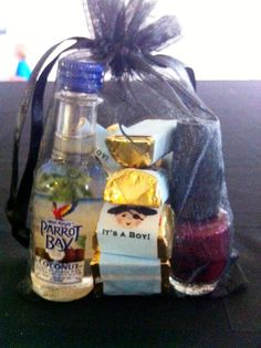 "Shower favors were a hit I think.  Bottle of ""Parrot Bay"" or ""Captain"" rum with the custom wrapped Hershey Nuggets and a bottle of OPI nail polish in colors that are from their ""French"" themed line.  Oui!"