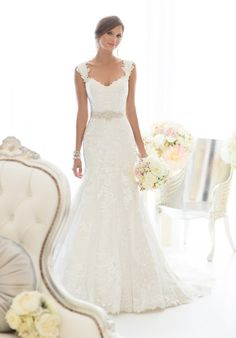 All-over lace fit and flare wedding gown with beading throughout the wedding dress and cap sleeves // D1617 from Essense of Australia