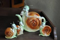 Whimsical, Original Snappy the Snail set: teapot, ashtray and two shakers. The color on all pieces is bright and vivid. All pieces are ceramic and the anteneas are clear plastic.  Size: Teapot is 8 tall with the antenea x 8 long, ashtray is 4 x 3 x 1 and each shaker is 3.75 tall x 2.75 wide x 1.25 deep.  Teapot is in excellent condition with no chips or damage. There is an Enesco foil label on the bottom but no tag. Light crazing.  Shakers: I found this set at an estate sale but I have…