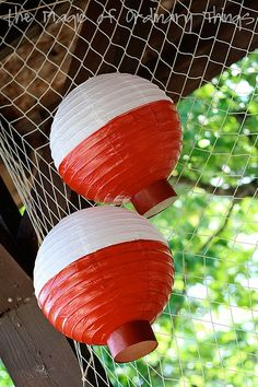 Fishing Themed Birthday party - paper lanterns turned bobbers  Great fish party decor!