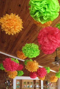 If you're looking for a pop of color for your next party's centerpiece or to hang from above, this is a must try for you! These are amazing when used as homemade wedding or shower decor. Here's a p…